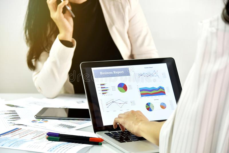 Business strategy planning, Business women discuss and review data documents. royalty free stock photo