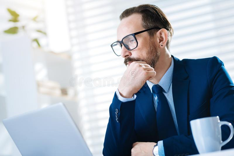 Handsome bearded man watching report royalty free stock image