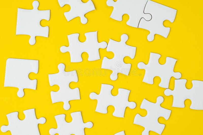 Business strategy for success metaphor or various solutions to s. Olve problem concept, jigsaw puzzle pieces on yellow background stock image