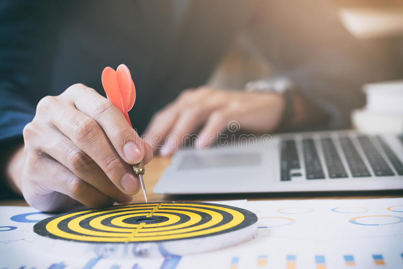 Business strategy success target goals. Businessman holding red dart push on target. Business strategy planning success target goals. Business development stock photos