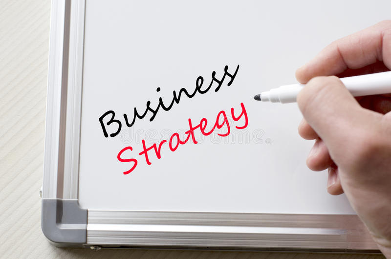 Business strategy written on whiteboard royalty free stock photos
