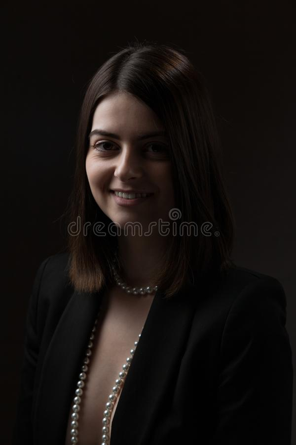 Business style dressed woman in black jacket. stock photos