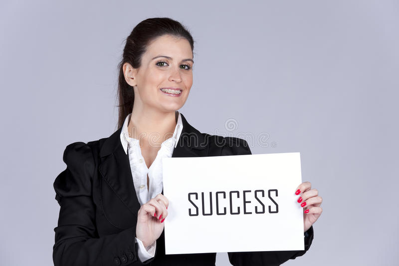 Business success. Businesswoman holding a paper with the word Success stock photography