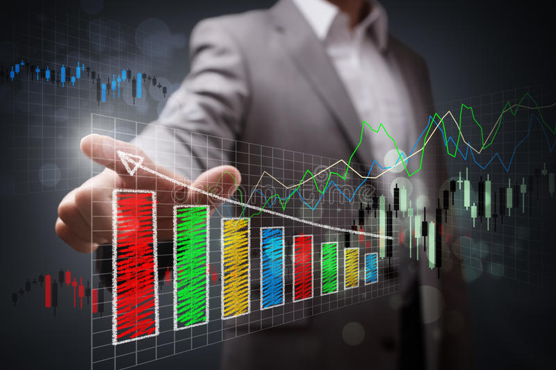 Business success. Businessman pointing to a growth chart showing business success stock photo