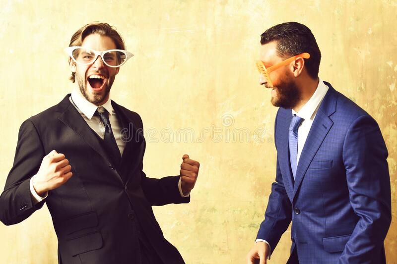 Business success concept. businessmen in suits and funny glasses celebrating deal royalty free stock image