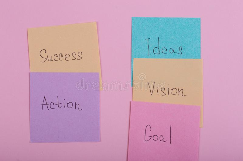 Business and success concept - colorful sticky notes with words success, action, goal, vision, idea royalty free stock photos