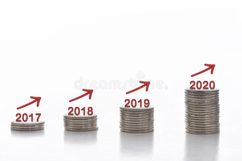 Business success concept and growth idea. Stack of coins with 2017 to 2020 and arrow on white background, business success concept and growth idea stock photos
