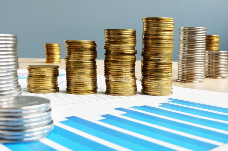 Business success. Profit. Stack of coins and financial chart. stock photo