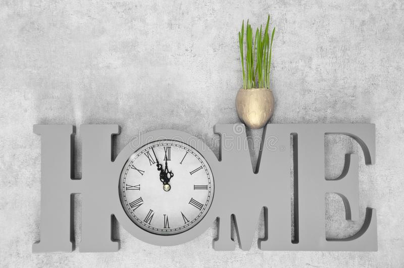 Business success and finance, secure investment choice. Family values and love, family house. Clock show time with fresh green gra. Ss in gold egg, home. Time stock images