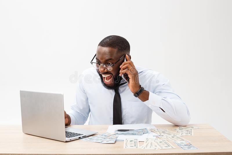 Business and success. Handsome successful African American man wearing formal suit, using laptop computer for distant stock images