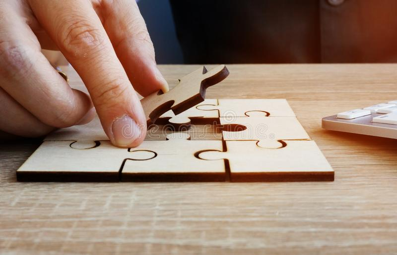 Business success and problem solving. Man holds piece of puzzle. Business success and problem solving concept. Man holds piece of puzzle royalty free stock image