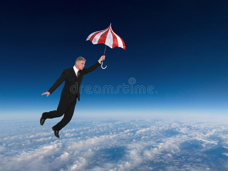 Business Success, Sales, Marketing, Flying. A businessman is flying with an umbrella above the clouds in a blue sky. Abstract concept for business, success, jobs stock images