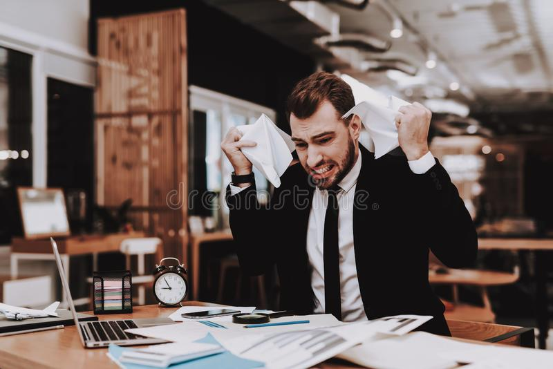 Business Suit. Disappointed. Large Amount of Work. Business Suit. Disappointed Large Amount of Work Workplace Ideas. Project Laptop. Sit Brainstorm Young Guy royalty free stock photo