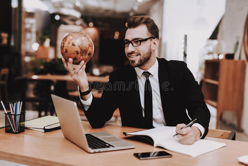 Business Suit. Globe. Project. Laptop. Sit. Guy royalty free stock image