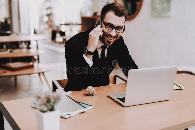Business Suit. Talking on Phone. Project. Laptop stock photos