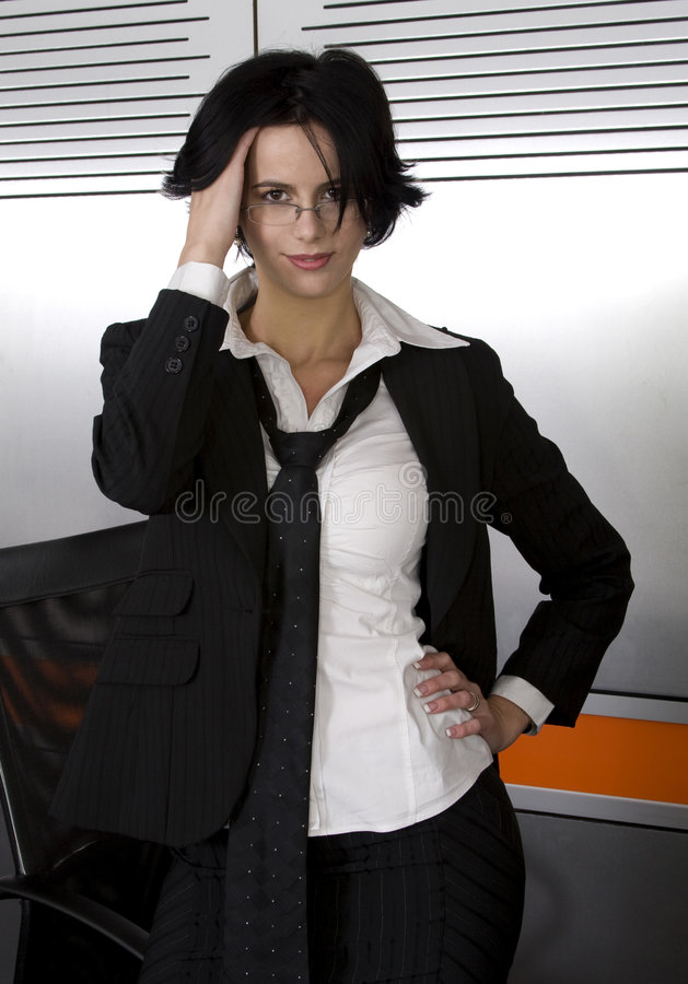 Business suit woman. Attractive brunette business woman wearing suit stock photos