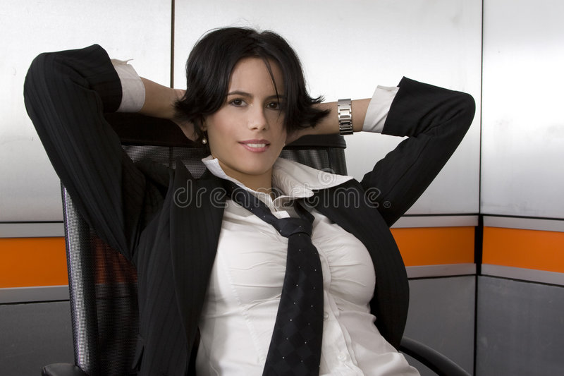Business suit woman. Attractive brunette business woman wearing suit stock photo