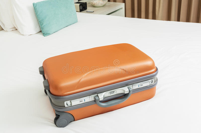 Business suitcase on bed stock photo