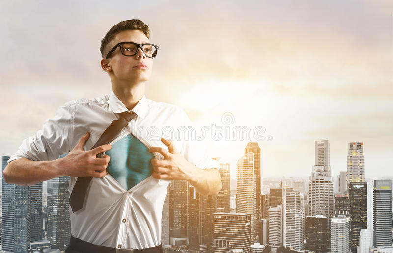 Business super hero hover over city skyline. Business superhero. Young businessman showing super hero suit under his shirt down town on sunset stock images