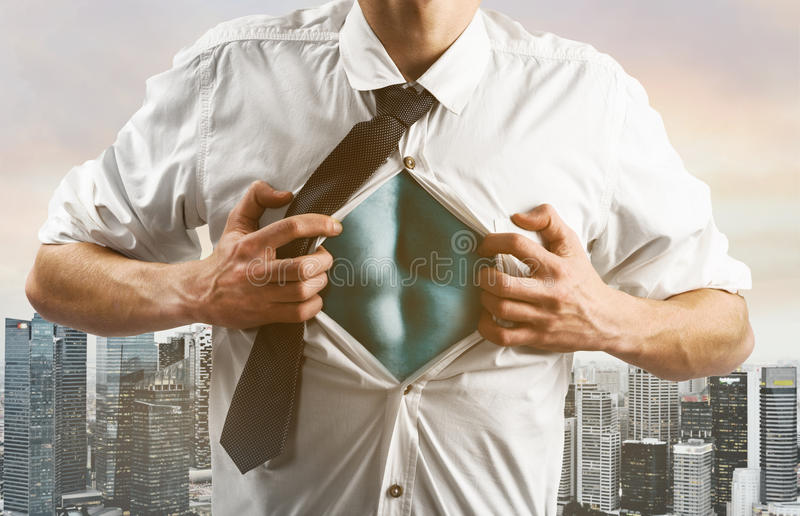 Business super hero hover over city skyline. Business superhero. Young businessman showing super hero suit under his shirt down town on sunset royalty free stock photo