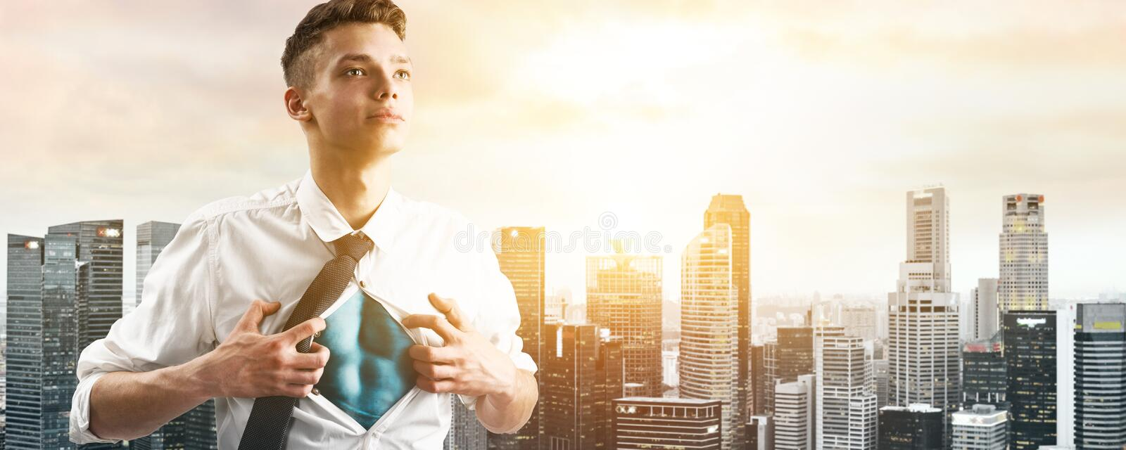 Business super hero hover over city skyline. Business superhero. Young businessman showing super hero suit under his shirt down town on sunset royalty free stock photos