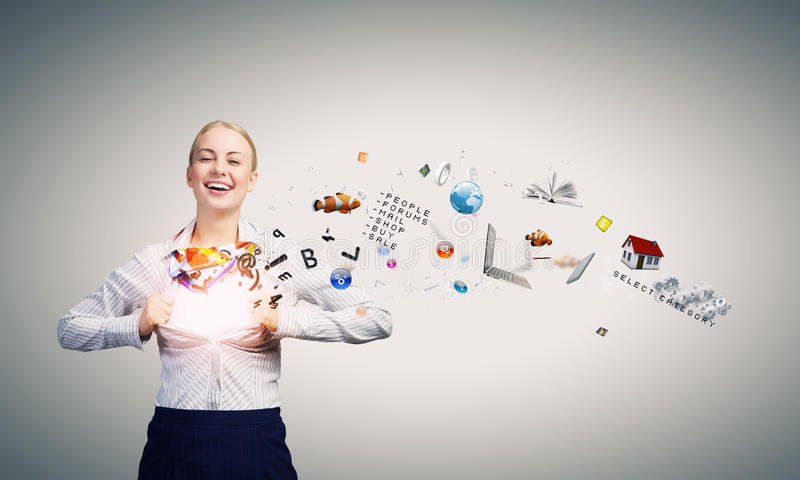 Business super power. Young attractive businesswoman opening her shirt like superhero royalty free stock images