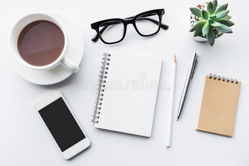 Business table top with mock up office supplies on white. Background.Flat lay design.Copy space royalty free stock photography