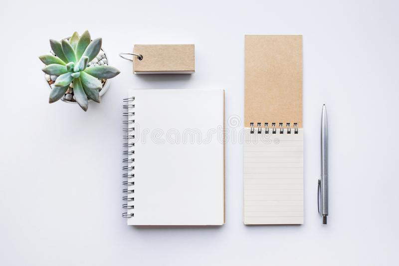 Business table top view with mock up Office supplies on white. Background.Flat lay design.Copy space royalty free stock photos