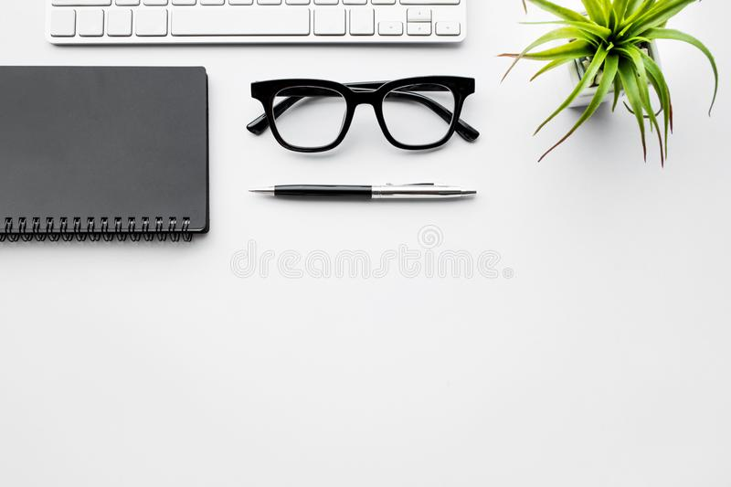 Business table top view with mock up Office supplies on white stock images