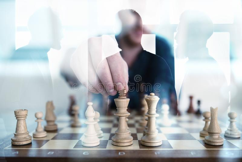 Business tactic with chess game and businessmen that work together in office. Concept of teamwork, partnership and royalty free stock images