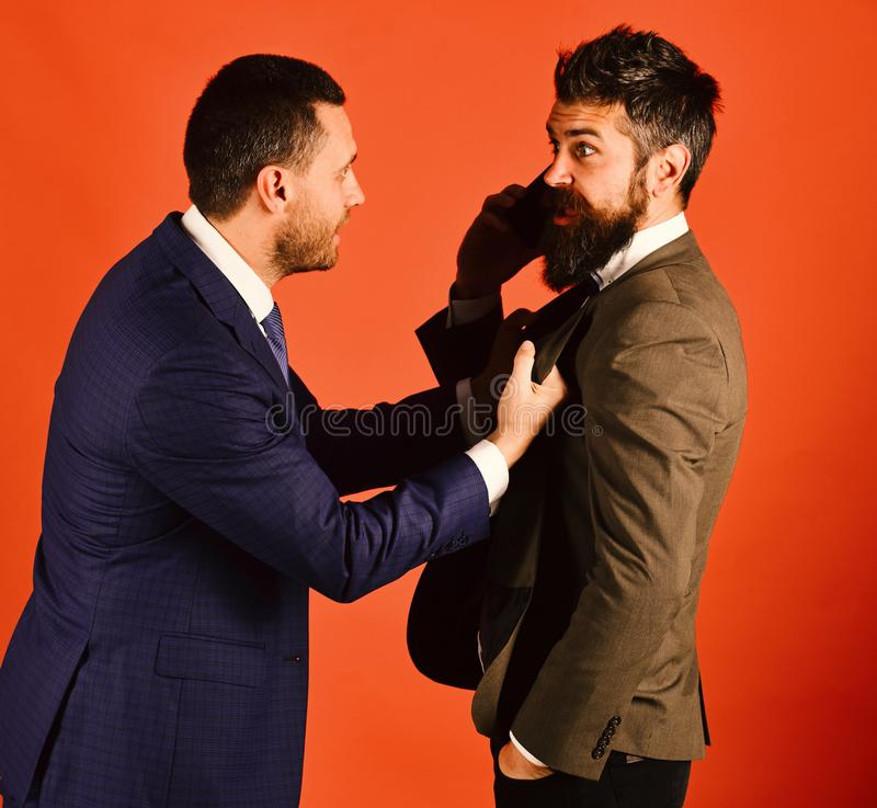 Business talk and rivalry concept. Men with beards ready to fight on red stock photo