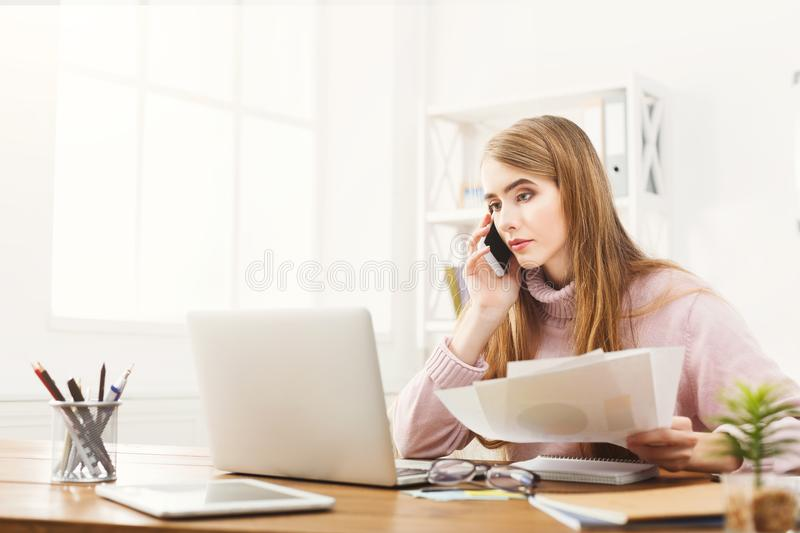 Business talk, woman consulting by phone at office royalty free stock photos
