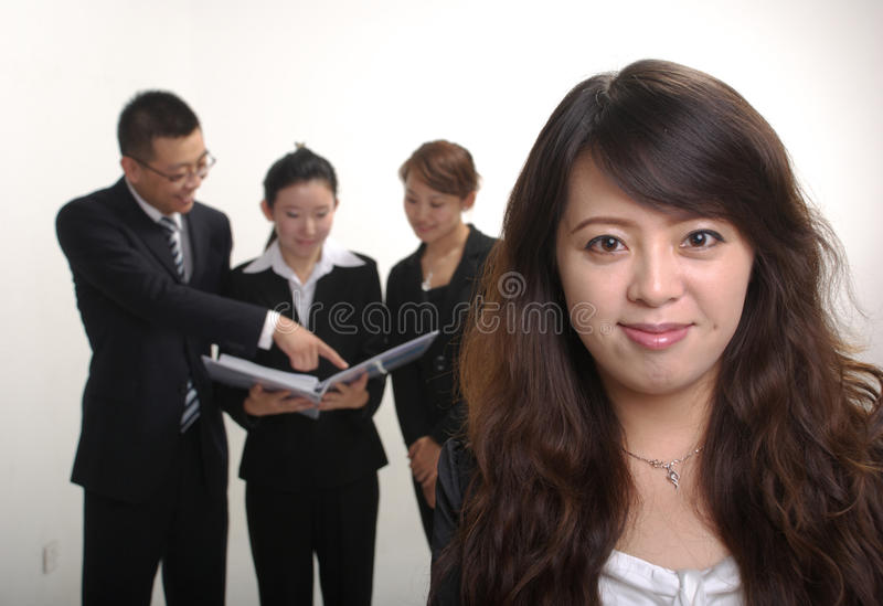 Business team. With a woman portrait royalty free stock photography