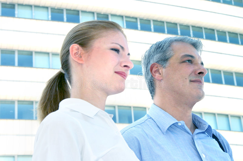 Business Team. Portrait of two business colleagues standing outside an office building stock photo