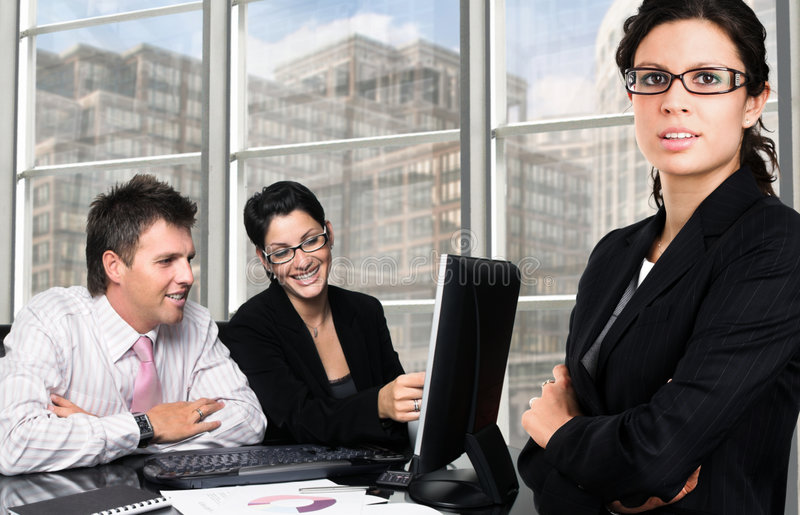 Business team. Young and good-looking business people are working in team in a exclusive office