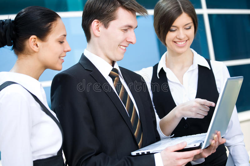 Business team. Young business people working on laptop in modern office building stock photo