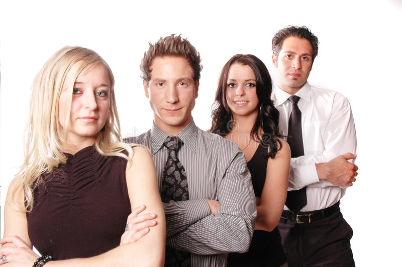 A business team. Business team with its members are posing stock image