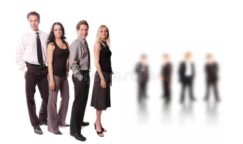 A business team. Business team with its members are posing royalty free stock photo