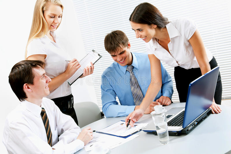 Business team. Young business people working in the office stock photo