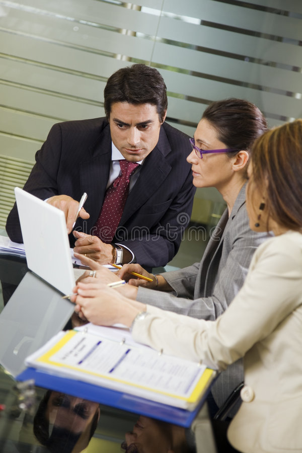 Business team. People at work: business team having a meeting royalty free stock photography
