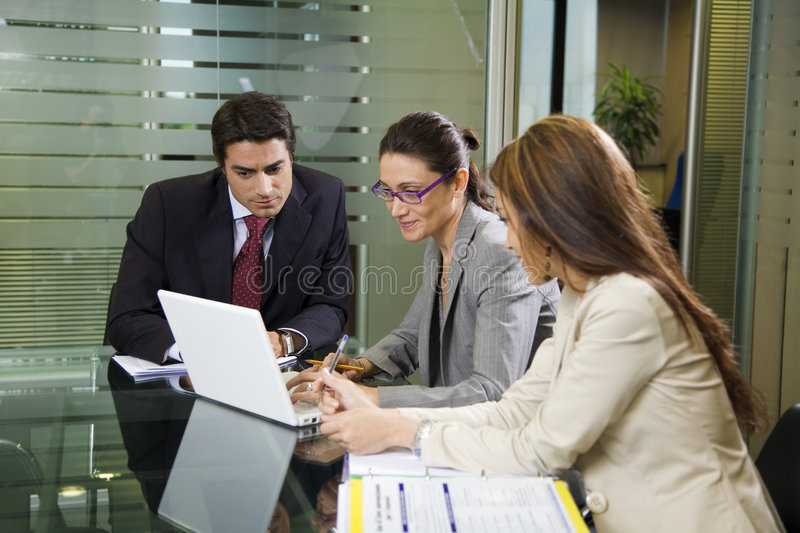 Business team. People at work: business team having a meeting stock photo