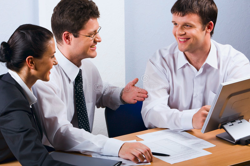 Business team. Business people talking at the workplace