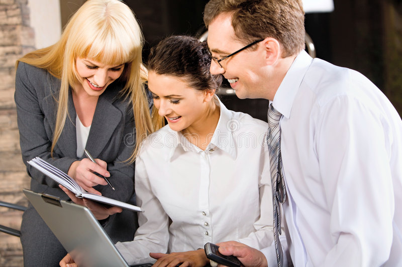 Business team. Of three professionals discussing a strategy-business stock photos
