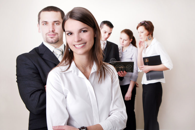 Business Team. Successful Business Team in a office environment looking satisfied royalty free stock images