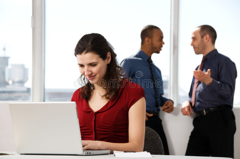 Business Team. With a woman in the foreground stock images