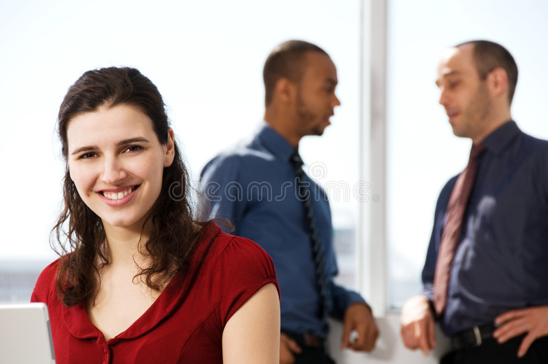 Business Team. With a woman in the foreground royalty free stock photography