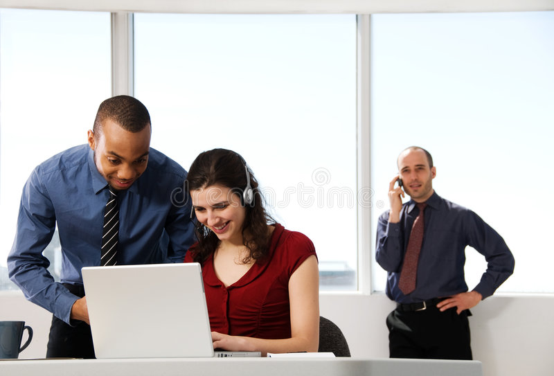 Business Team. With a woman in the foreground stock photos