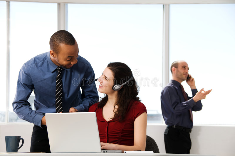 Business Team. With a woman in the foreground stock photo