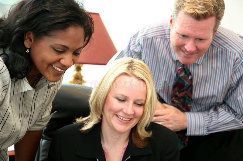 Business Team. In an office ready for the work day stock image