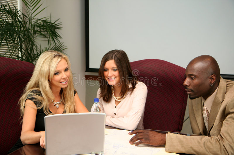 Business Team. In an office ready for the work day stock photo